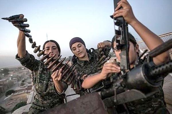Kurdish female fighters prepare for battle