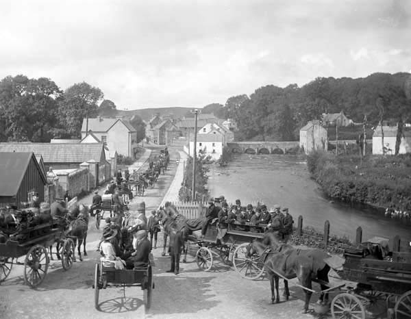 The main street of Pettigo, with the bridge into the village on the top right, c.1900