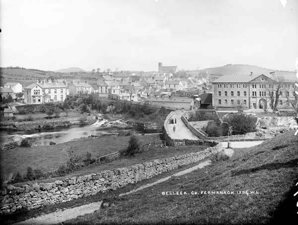 The town of Belleek, with the River Erne, crossed by a bridge, running across the middle of the image, c.1900