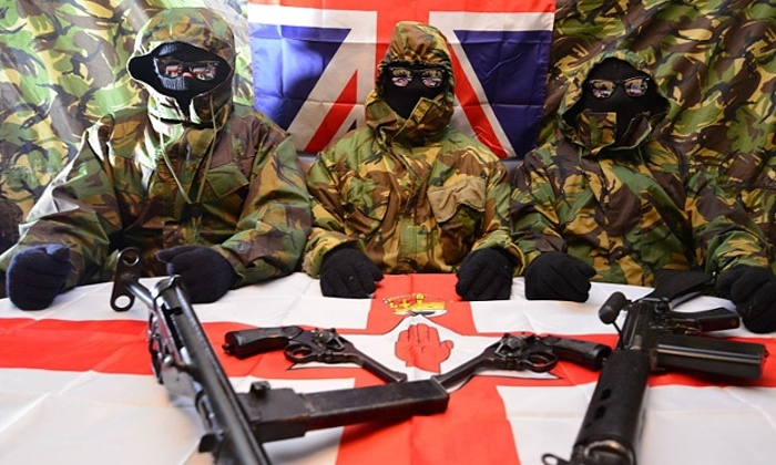 British terrorists pose with an L1A1 Self-Loading Rifle, two Webley Mk IV Service Revolvers, a home-made Sterling submachine gun
