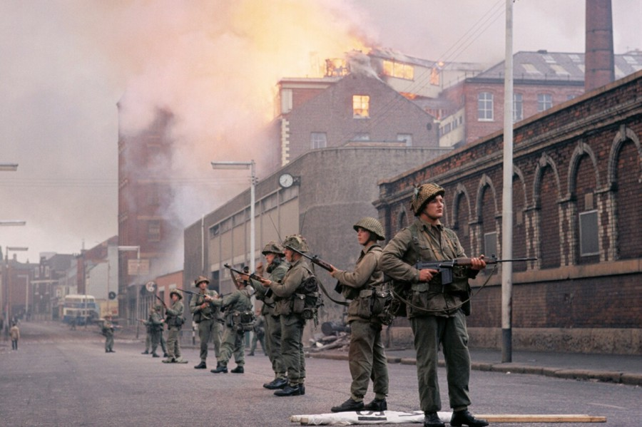 British troops take up positions on the streets of Derry in the wake of an Irish civil rights protest, Ireland, August 1969