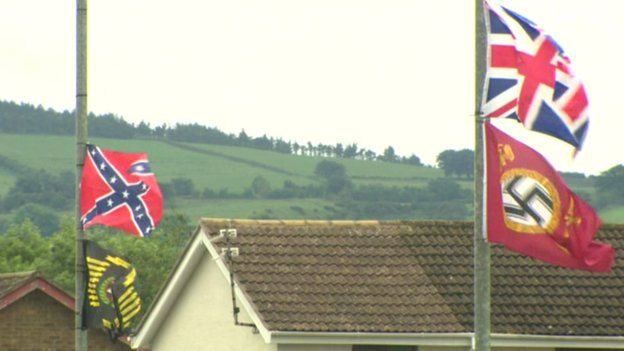 Confederate, Nazi and British terrorist banners erected by extreme unionists or UK separatists in Ireland fly over the town of Carrickfergus