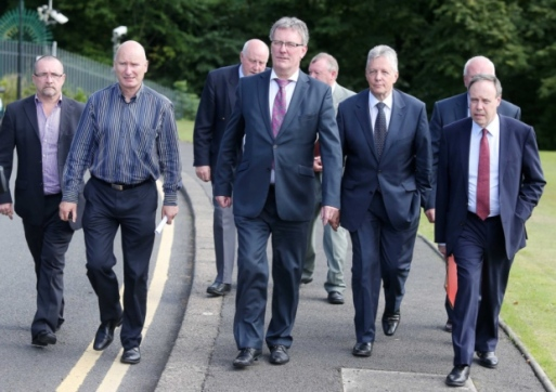 Billy Hutchinson, Mike Nesbitt and Peter Robinson. The leaders of the UUP and DUP step side-by-side with the leaders of the British terrorist-linked PUP