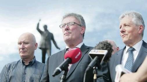 Billy Hutchinson of the British terrorist-linked PUP, Mike Nesbitt of the UUP and Peter Robinson of the DUP stand shoulder-to-shoulder