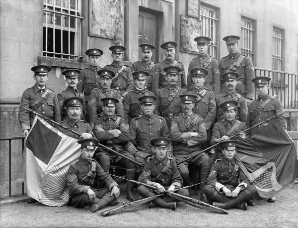 Officers and NCOs of the Redmond-led Irish National Volunteers, Waterford, April 1915. Note the Gal Gréine or Sunburst flag