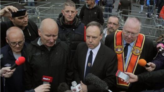 PUP leader Billy Hutchinson, senior DUP politician Nigel Dodds and Mervyn Gibson of the Orange Order
