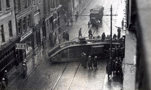 A British Army Mark V tank rams a sealed premises on Capel Street, Dublin, January 18th 1921, during destructive house-searches by the UK Occupation Forces in Ireland