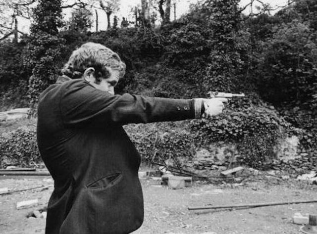 Martin McGuinness, pictured firing a Luger P08 semi-automatic pistol while serving as a volunteer of the Irish Republican Army, Derry, 1972