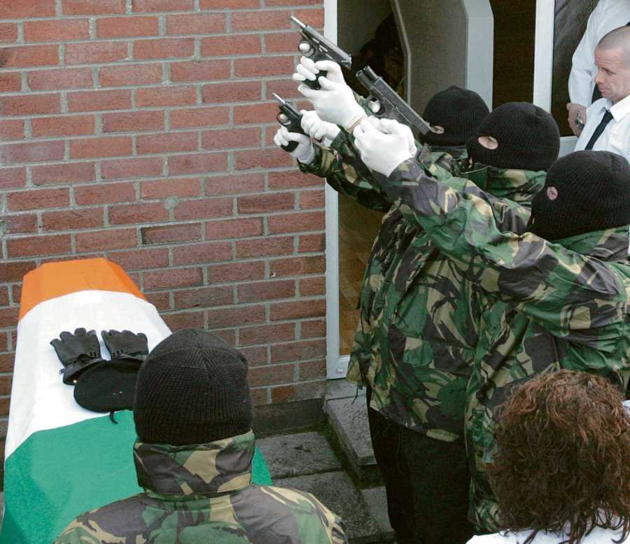Volunteers of the Real Irish Republican Army or Real IRA, RIRA, fire a volley of shots at a republican funeral