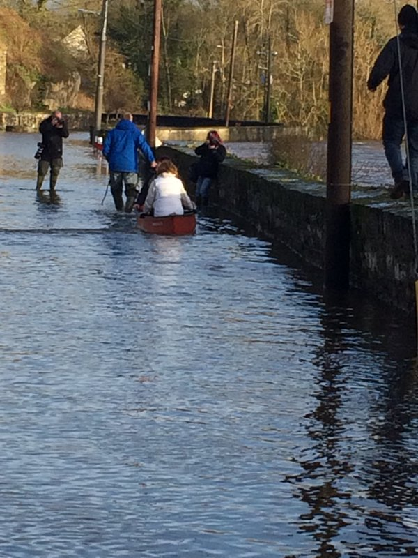 An tánaiste and Labour boss, Joan Burton, in a boat, in a flood, in a photo stunt for the press