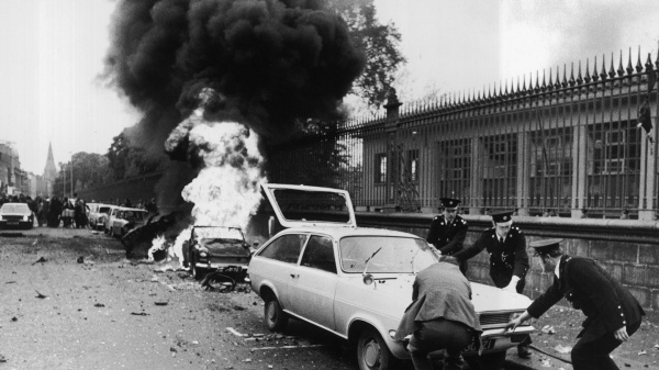 Burning cars and buildings on Nassau Street, Dublin, in the aftermath of British terror attacks on the Irish capital, Ireland, 1974