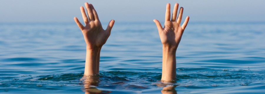 Drowning, hands in the sea