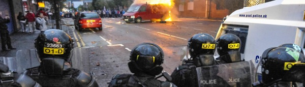 Riot police at the scene of a riot by loyalists protesting against a republican parade