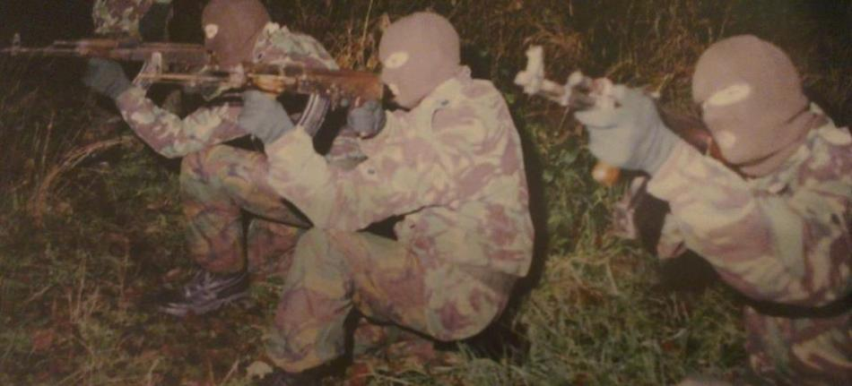 Volunteers of the East Tyrone Brigade, Irish Republican Army, armed with AIM assault rifles, British Occupied North of Ireland