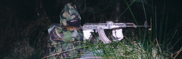 A volunteer of the Real Irish Republican Army or RIRA, armed with an AIM assault rifle