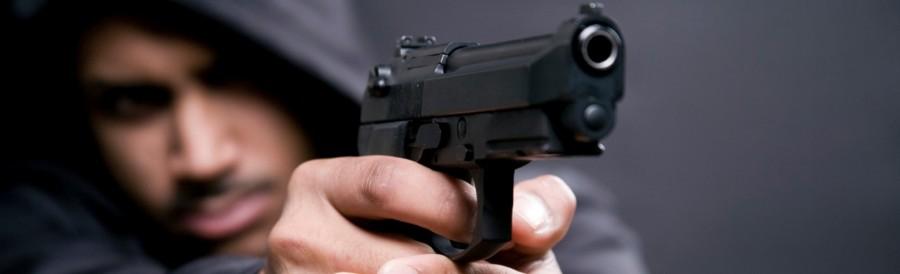 Criminal terrorist with gun pointing