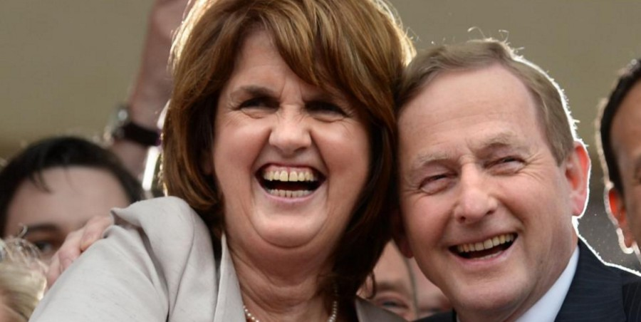 Labour's Joan Burton and Fine Gael's Enda Kenny give free hugs