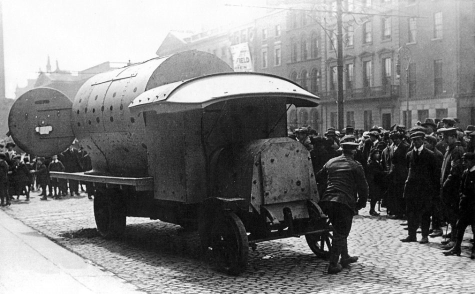 "An improvised armoured personnel carrier of the British Army during the 1916 Easter Rising, informally known as a ""boiler"" by users and observers. Note the rear door, the original hatch on the steam box"