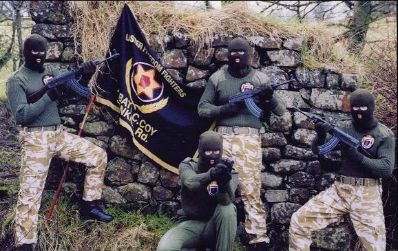 Gunmen of the UDA-UFF, a British terror faction, armed with UK-supplied weapons