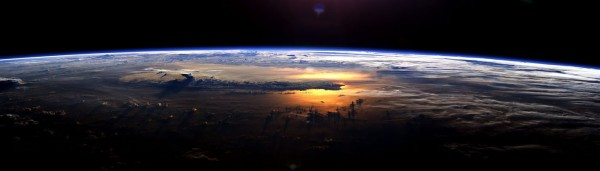 Sunrise on the Earth from space orbit, a science-fiction view