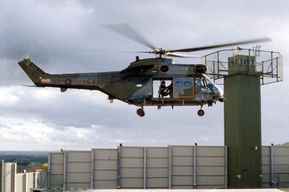 A British RAF Aérospatiale SA 330 Puma helicopter lands at a fortified UK base in the Occupied North of Ireland