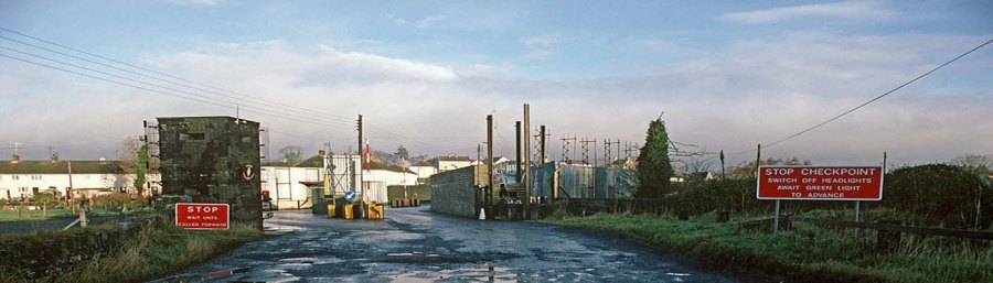 A heavily fortified British permanent vehicle checkpoint (PVC) in the UK Occupied North of Ireland. Note the use of civilian housing to provide a human shield for the outpost