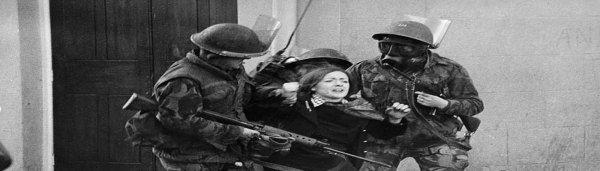British soldiers assault an Irish woman during civil rights protests in the UK Occupied North of Ireland, 1970s