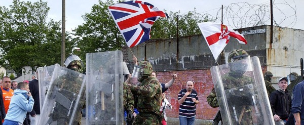 British soldiers escort unionist Orange Order members forcibly marching through an Irish nationalist enclave, UK Occupied North of Ireland