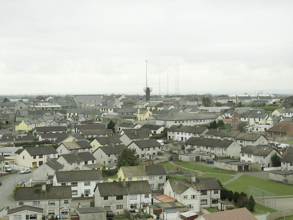 Civilian homes provide human shields for the British soldiers confined to the fortified UK military outpost in Crossmaglen, Occupied North of Ireland