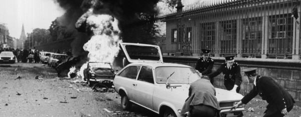 Gardaí move a vehicle away from the scene of a massive explosion during the Dublin - Monaghan Bombings of May 1974