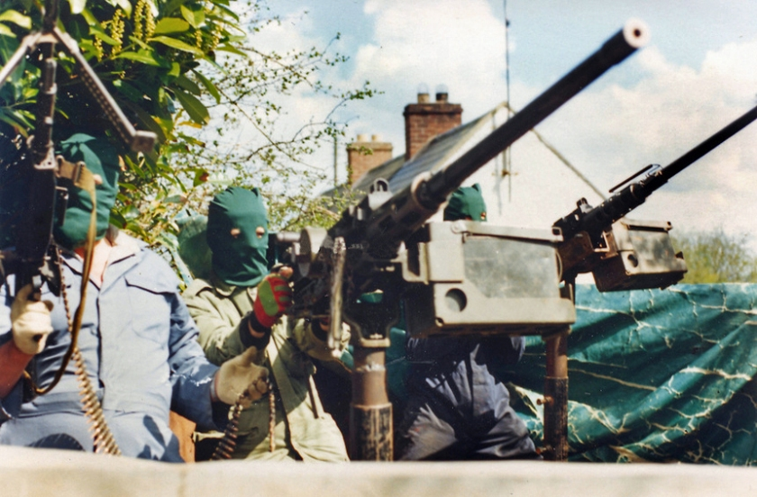 Three volunteers of the South Fermanagh Brigade, Irish Republican Army, stand in the back of an improvised armoured truck with American-supplied M2 Browning .50 Calibre heavy machine guns, February 1977