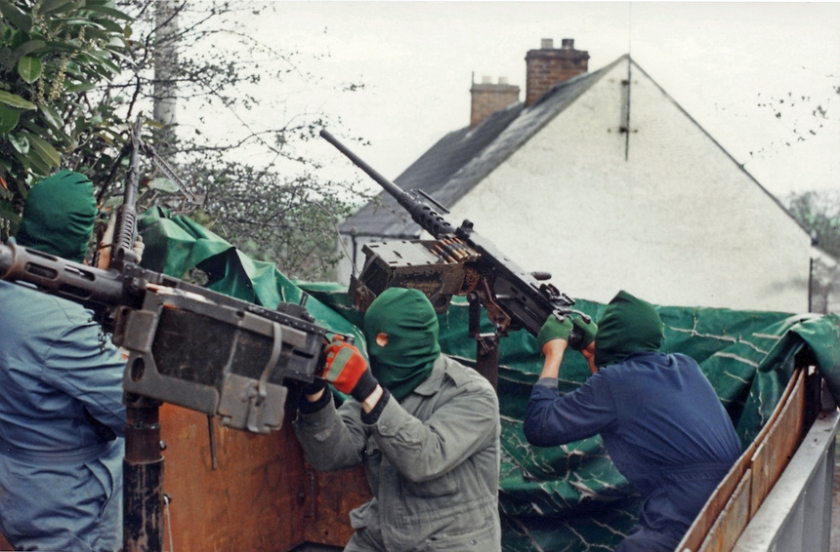 Volunteers of the South Fermanagh Brigade, Irish Republican Army, man American-supplied M2 Browning .50 Calibre heavy machine guns on the rear of an improvised fighting vehicle, February 1977