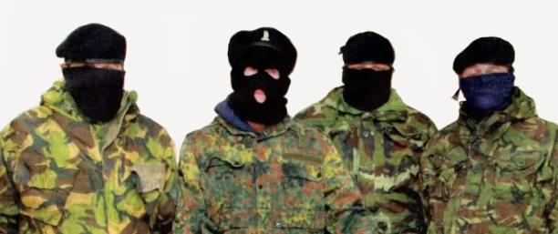 Volunteers of the Irish insurgent grouping, Óglaigh na hÉireann or ÓnaÉ, in a press conference