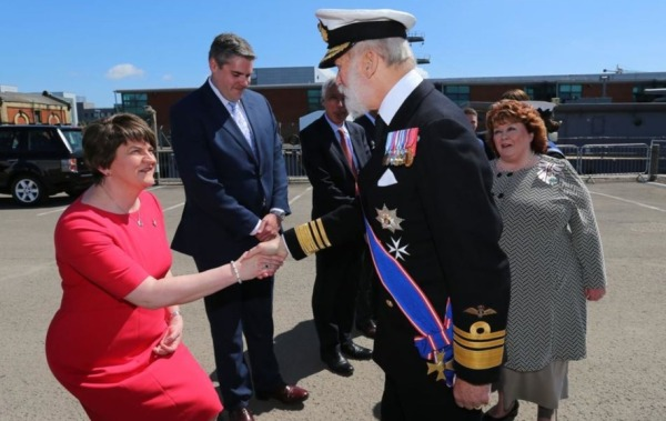 The unionist politician Arlene Foster, leader of the DUP, fawns over a minor member of the British royalty during a visit to the UK Occupied North of Ireland